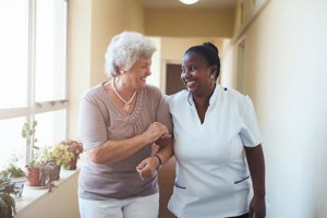 a woman benefits from an assisted living community