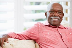 a man is happy with his senior living programs