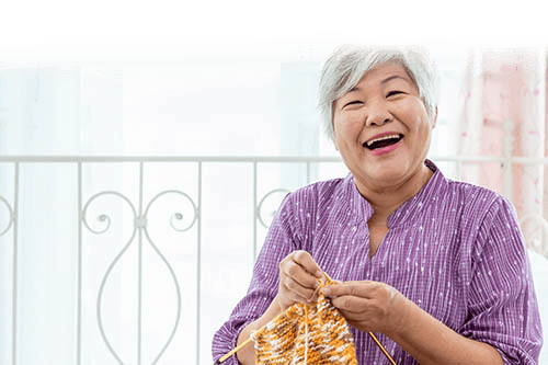 Old Women Smiling while Knitting Regency Pointe