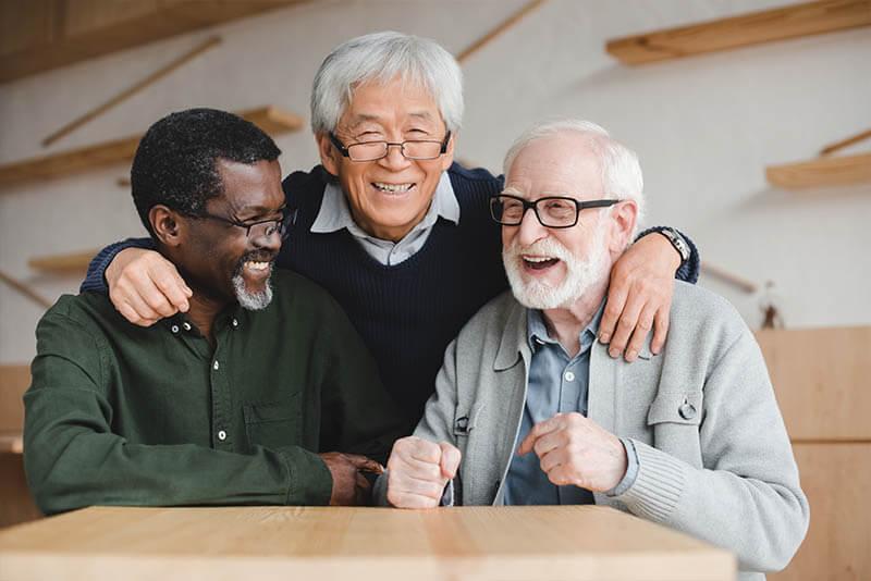 Group of Old Men Smiling at Regency Pointe