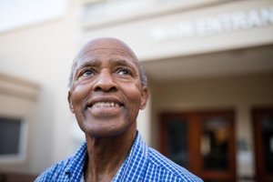 a man is looking forward to learning about his senior living options in alabama